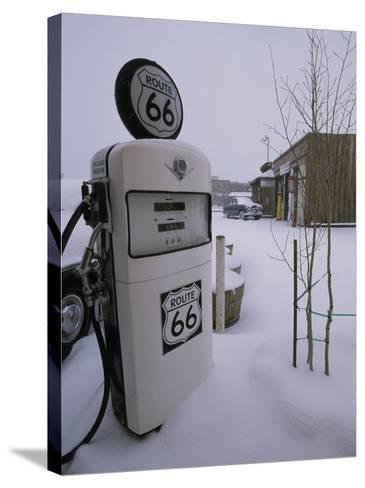 Snow-Covered Gas Pump on Historic Route 66-Rich Reid-Stretched Canvas Print