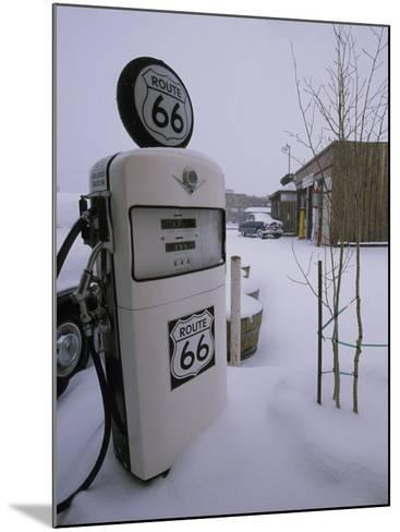 Snow-Covered Gas Pump on Historic Route 66-Rich Reid-Mounted Photographic Print