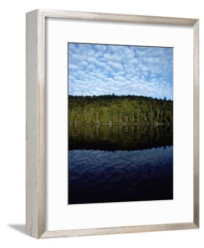 Shoreline and Clouds Reflected in the Still Waters of Rainbow Lake-Sam Abell-Framed Art Print