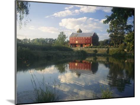 An Old Red Barn Reflected in a Pond-Richard Nowitz-Mounted Photographic Print