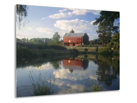 An Old Red Barn Reflected in a Pond-Richard Nowitz-Metal Print
