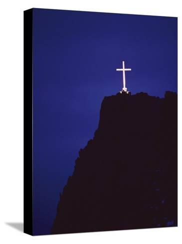 A Large Cross Situated on a Rocky Headland-George F^ Mobley-Stretched Canvas Print