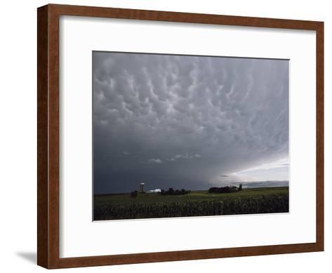 Storm Clouds over a Farm-Annie Griffiths Belt-Framed Art Print