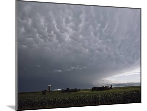 Storm Clouds over a Farm-Annie Griffiths Belt-Mounted Photographic Print
