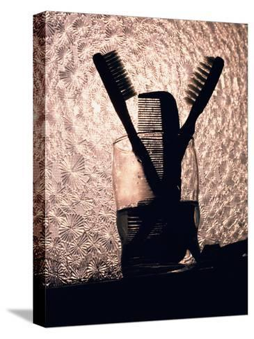 A Comb and Two Toothbrushes on a Bathroom Windowsill-Stephen St^ John-Stretched Canvas Print