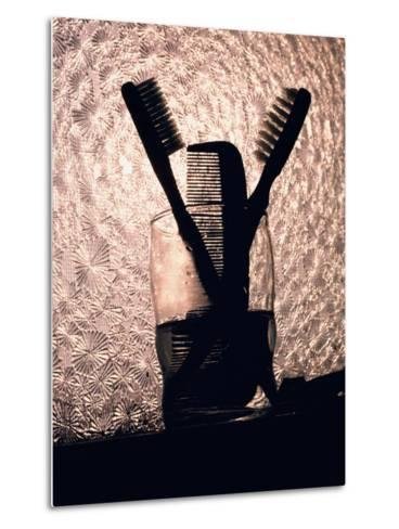 A Comb and Two Toothbrushes on a Bathroom Windowsill-Stephen St^ John-Metal Print