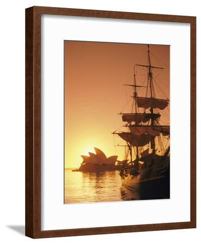 Sydney Opera House and the Hms Bounty, a Replica of the Famous Ship, Silhouetted by the Setting Sun-Richard Nowitz-Framed Art Print