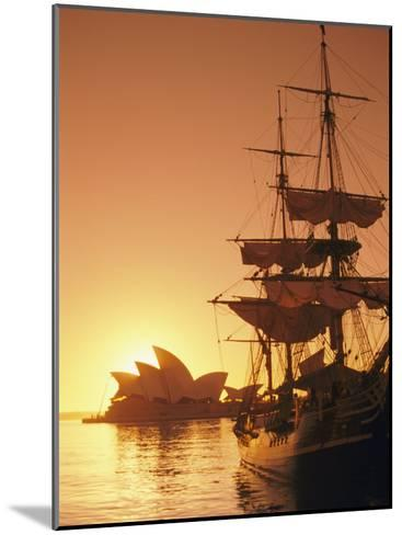 Sydney Opera House and the Hms Bounty, a Replica of the Famous Ship, Silhouetted by the Setting Sun-Richard Nowitz-Mounted Photographic Print