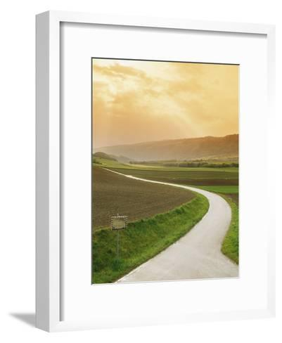 The Golden Sun Glows Through Cloud Cover to Illuminate a Country Road-Richard Nowitz-Framed Art Print