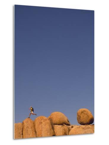 Hiker Jumping on Rocks-Bill Hatcher-Metal Print