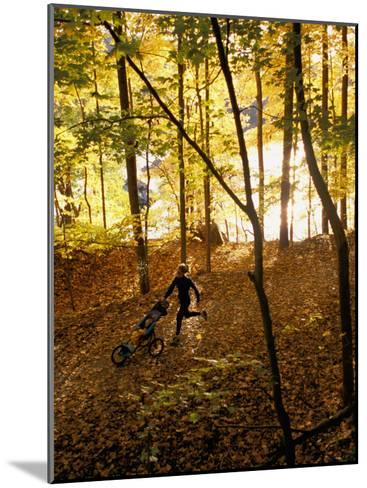 A Woman Pushes a Baby Stroller as She Jogs Through a Wooded Area-Skip Brown-Mounted Photographic Print