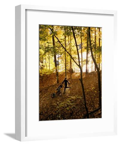 A Woman Pushes a Baby Stroller as She Jogs Through a Wooded Area-Skip Brown-Framed Art Print
