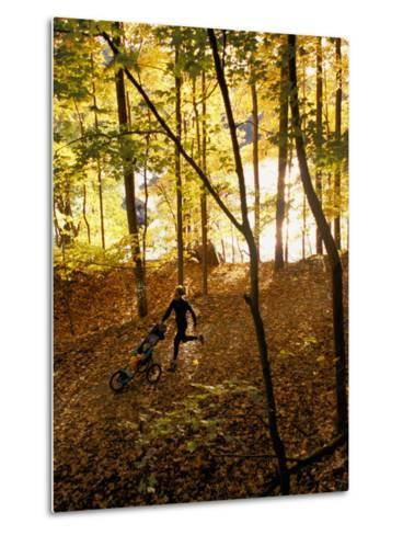 A Woman Pushes a Baby Stroller as She Jogs Through a Wooded Area-Skip Brown-Metal Print