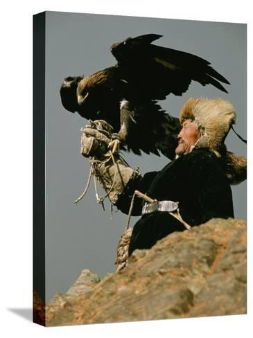 A Kazakh Man Supports His Trained Golden Eagle-David Edwards-Stretched Canvas Print