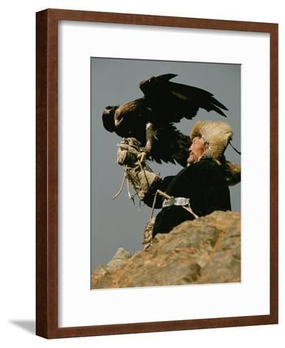 A Kazakh Man Supports His Trained Golden Eagle-David Edwards-Framed Art Print
