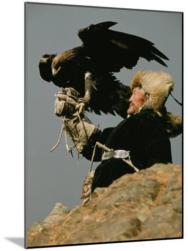 A Kazakh Man Supports His Trained Golden Eagle-David Edwards-Mounted Photographic Print