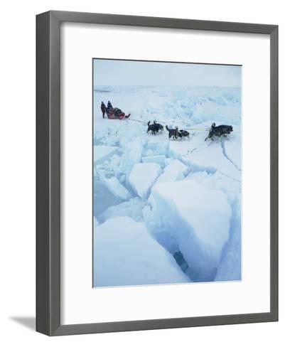 Huskies Carry a Sled Across Broken Ice During an Expedition Traversing the North Pole-Gordon Wiltsie-Framed Art Print
