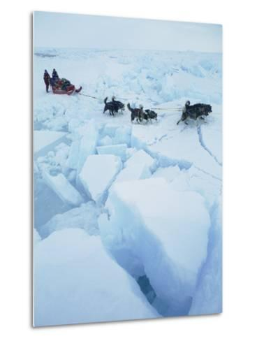 Huskies Carry a Sled Across Broken Ice During an Expedition Traversing the North Pole-Gordon Wiltsie-Metal Print