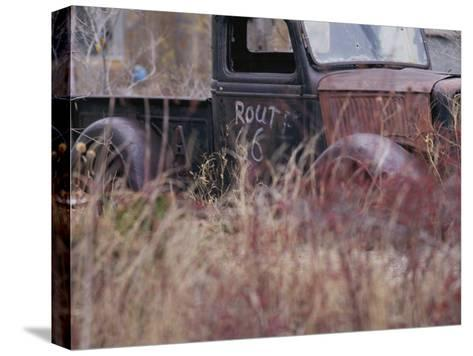 An Abandoned Old Truck Sits in a Field of Autumn Colored Grasses-Roy Gumpel-Stretched Canvas Print