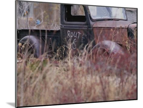 An Abandoned Old Truck Sits in a Field of Autumn Colored Grasses-Roy Gumpel-Mounted Photographic Print
