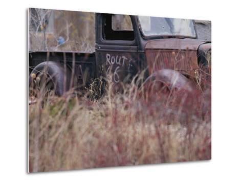 An Abandoned Old Truck Sits in a Field of Autumn Colored Grasses-Roy Gumpel-Metal Print