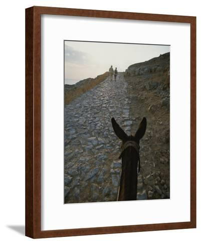 A Couple and a Donkey Walk up the Cobblestone Road to the Acropolis-Tino Soriano-Framed Art Print