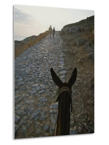 A Couple and a Donkey Walk up the Cobblestone Road to the Acropolis-Tino Soriano-Metal Print