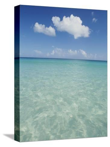 Aquamarine Water Bleeds into Blue Skies in This Tropical View-Michael Melford-Stretched Canvas Print