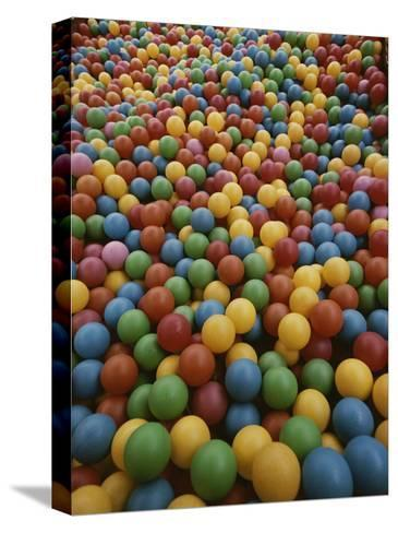 A Rainbow-Colored Landslide of Toy Balls in Abstract Patterns-Stephen St^ John-Stretched Canvas Print