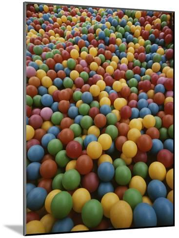 A Rainbow-Colored Landslide of Toy Balls in Abstract Patterns-Stephen St^ John-Mounted Photographic Print