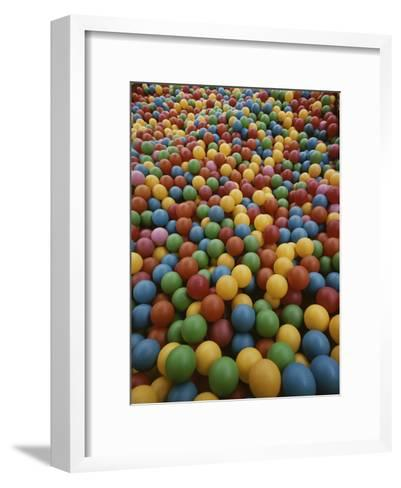 A Rainbow-Colored Landslide of Toy Balls in Abstract Patterns-Stephen St^ John-Framed Art Print