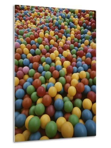 A Rainbow-Colored Landslide of Toy Balls in Abstract Patterns-Stephen St^ John-Metal Print