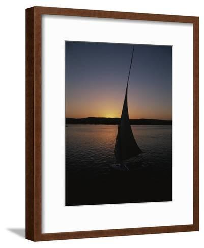 Sunset Outlines the Curve of a Felucca Sail on the Nile River-Stephen St^ John-Framed Art Print