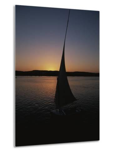 Sunset Outlines the Curve of a Felucca Sail on the Nile River-Stephen St^ John-Metal Print