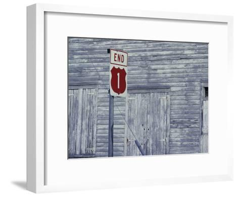 An Old Barn of Weathered Wood and a Road Sign-Medford Taylor-Framed Art Print