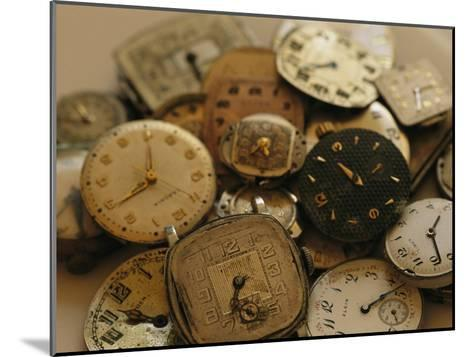 A Still Life of Old Watch Faces-Joel Sartore-Mounted Photographic Print