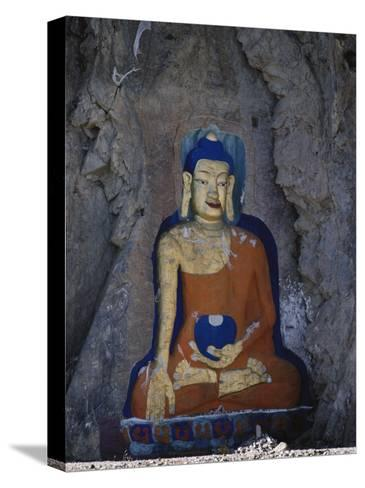 A Painted Stone Buddha Near Lhasa, Tibet-Gordon Wiltsie-Stretched Canvas Print