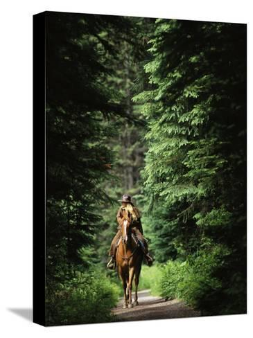 Horseback Riding on an Emerald Lake Lodge Bridle Trail-Michael Melford-Stretched Canvas Print