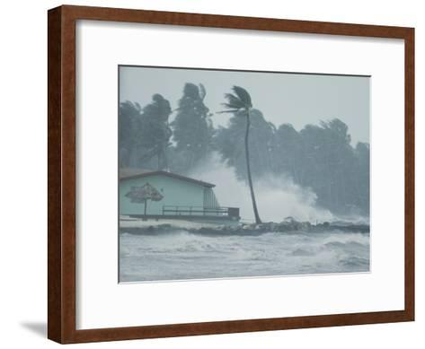 The Powerful Wind and Rain of a Hurricane Pummel a Building-Otis Imboden-Framed Art Print