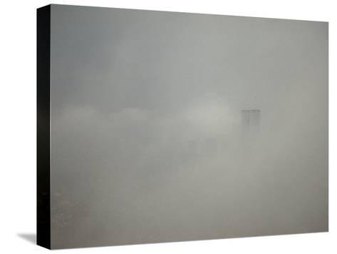 New York City with World Trade Center Through a Storm Front-Jason Edwards-Stretched Canvas Print