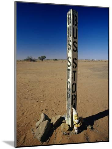 A Garden Gnome at a Bus Stop in an Outback Desert Town-Jason Edwards-Mounted Photographic Print