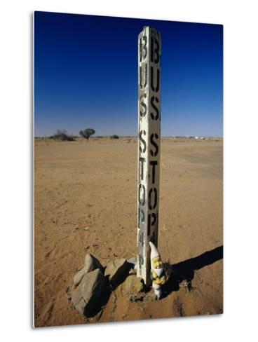 A Garden Gnome at a Bus Stop in an Outback Desert Town-Jason Edwards-Metal Print
