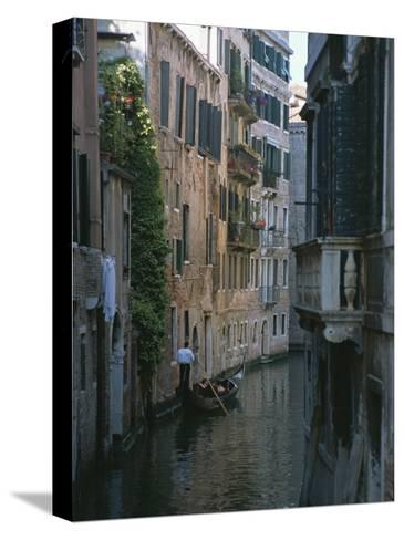 A Gondolier and Two Tourists on a Canal in Venice-Taylor S^ Kennedy-Stretched Canvas Print