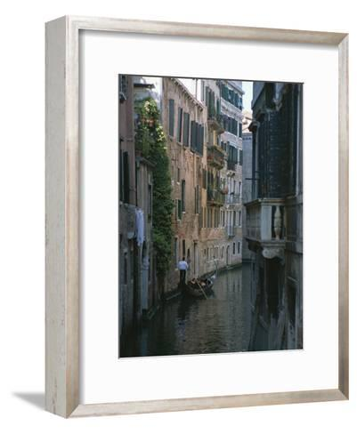 A Gondolier and Two Tourists on a Canal in Venice-Taylor S^ Kennedy-Framed Art Print