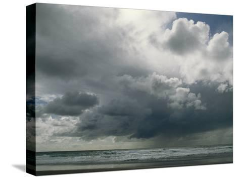 Dramatic Storm Clouds over Ocean Water-Charles Kogod-Stretched Canvas Print