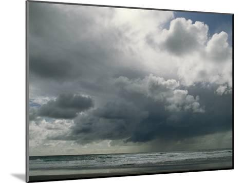 Dramatic Storm Clouds over Ocean Water-Charles Kogod-Mounted Photographic Print