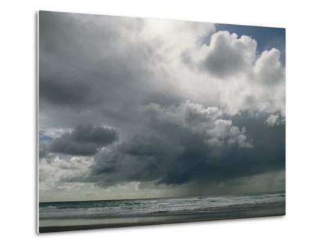 Dramatic Storm Clouds over Ocean Water-Charles Kogod-Metal Print