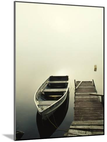 The Morning Sun Shines on a Rowboat Tied to a Dock-Stephen Alvarez-Mounted Photographic Print