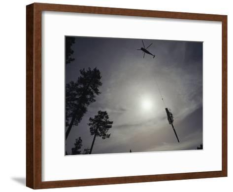 A Helicopter Lifts Cut Timber from the Forest; Helicopter Logging is Said to be Easier on Forest-Joel Sartore-Framed Art Print