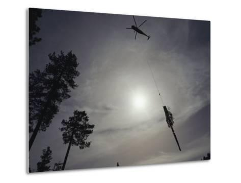 A Helicopter Lifts Cut Timber from the Forest; Helicopter Logging is Said to be Easier on Forest-Joel Sartore-Metal Print